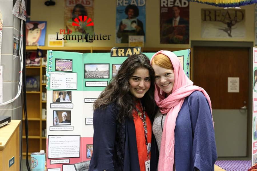 Sophomore Nasim Mohammadzadeh and Sophomore Abbi Fister  pose with their board of Iran.
