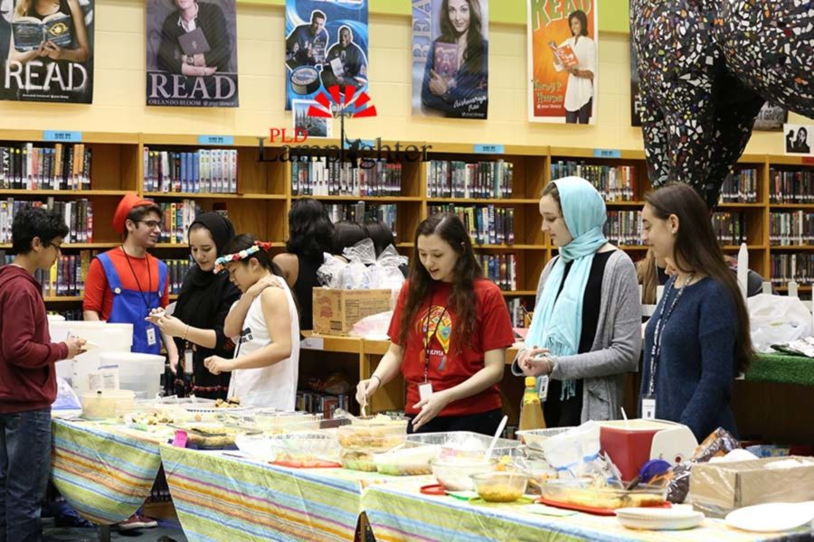 Dunbar Cultural Society members host a food area introducing visitors to international cuisine.