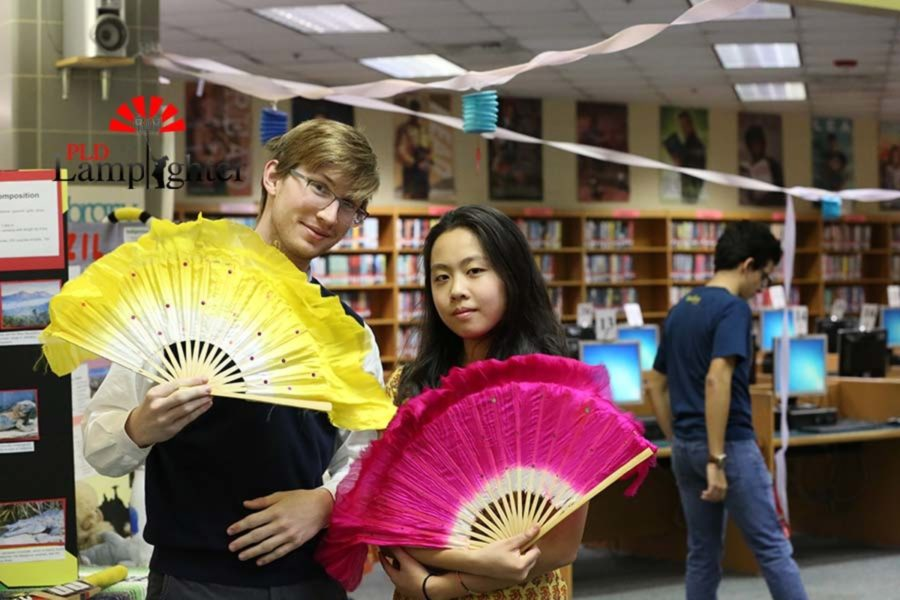 Senior Zachary Jones and Sophomore Angie Xiao pose for a photo with Chinese fans.