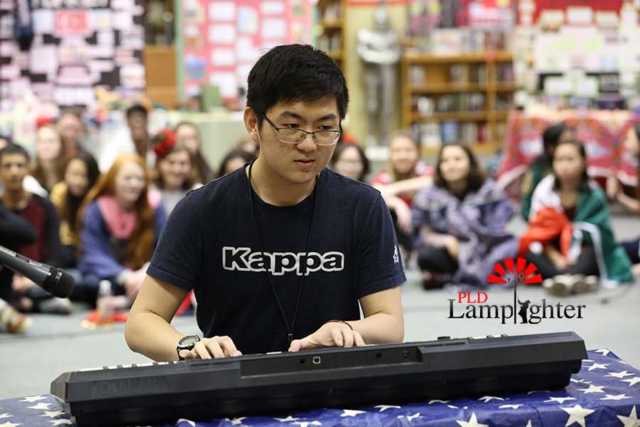 Sophomore Stephen Yin plays a classical Beethoven piece during the culture fair.