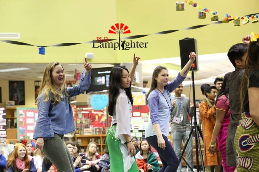 Students join in for the traditional African dance.