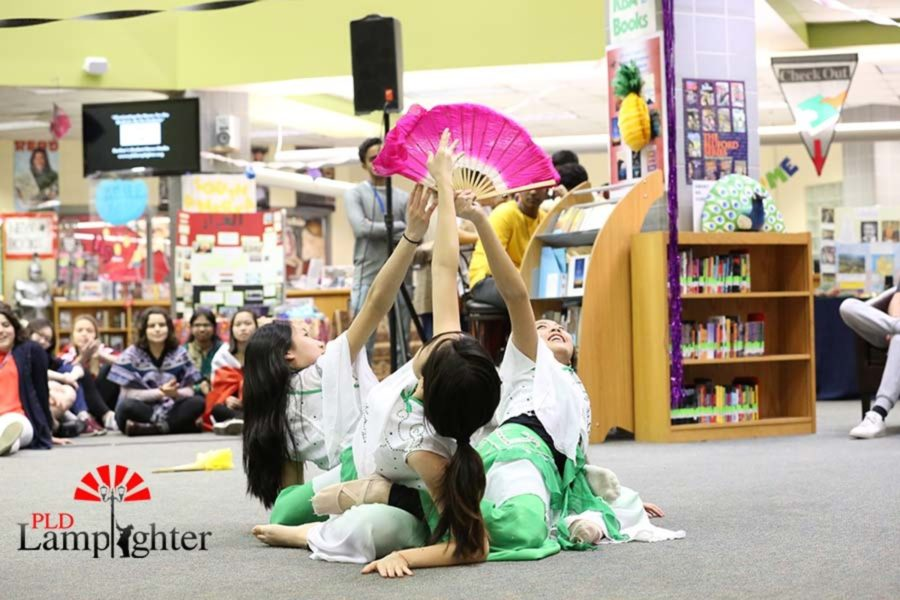 Freshman Wendy Wei, Senior Kelly Chen, and Sophomore Angie Xiao perform a traditional Chinese fan dance.
