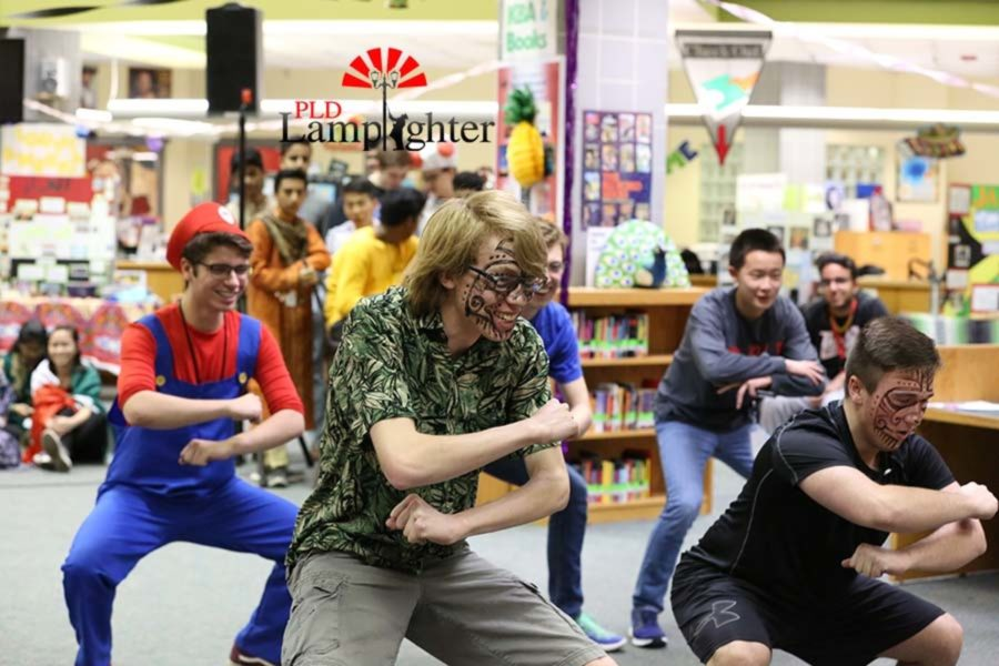 Senior Kevin Hutchenson, Chris Duncan, and others perform an African intimidation dance.