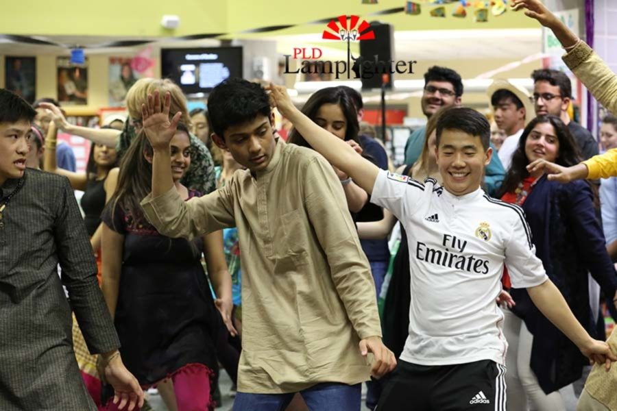 Senior Rohan Palla, Junior Kevin Jing, and others perform during the spontaneous African dance performance.