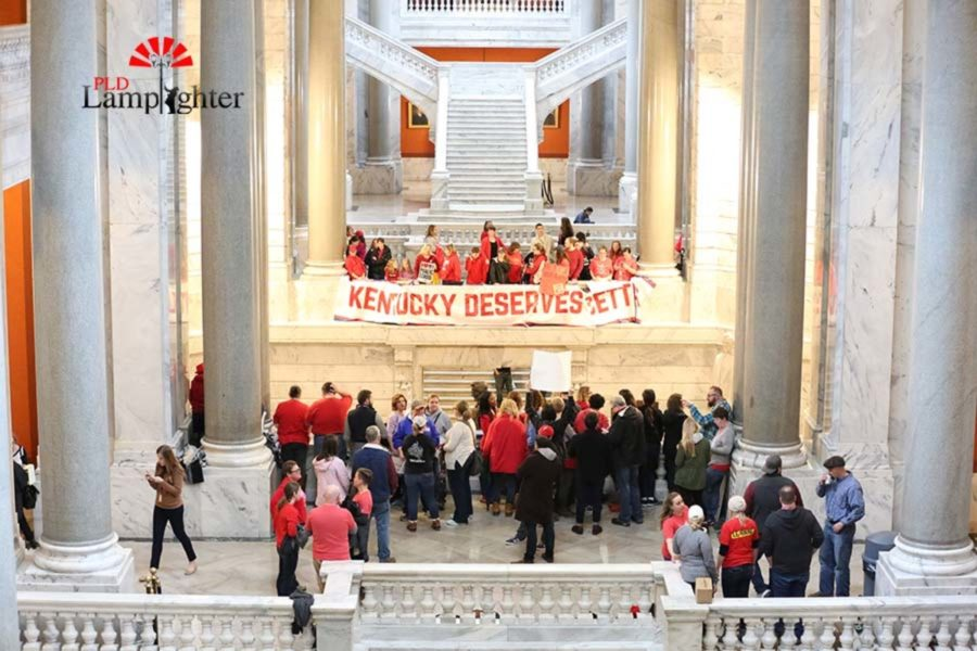 Kentucky Deserves Better banner hanging in the capitol.