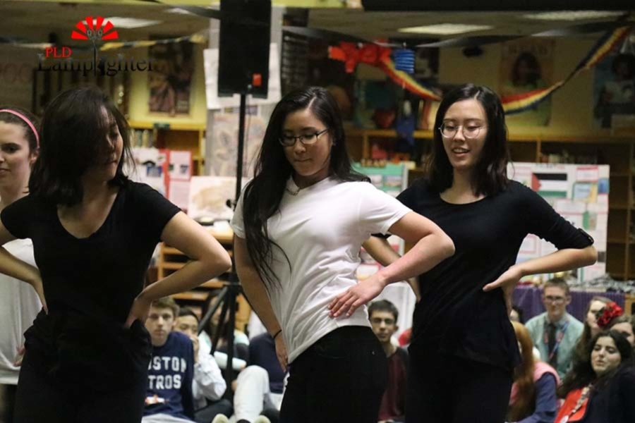 The Korean dance performance includes seniors Linda Kim, Hannah Wang, and Jin Cho.
