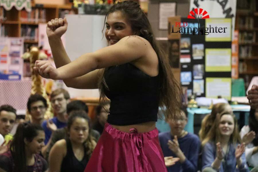 Senior Julia Radhakrishnan starts her performance during the Tollywood vs Korean music dance.