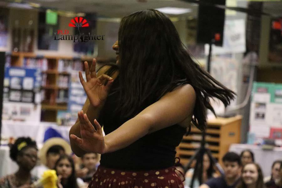 Senior Ellora Kamineni strikes a pose during the Tollywood vs Korean music dance.