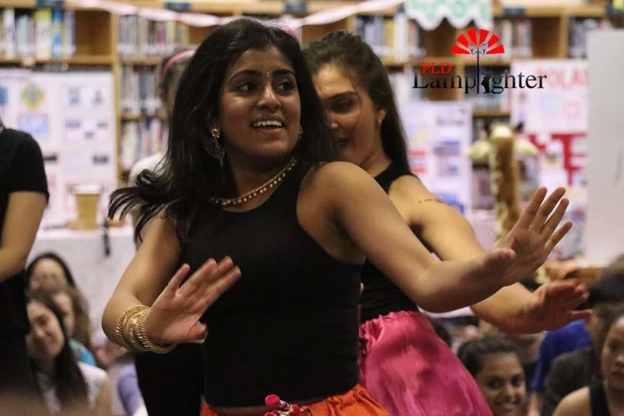 Freshman Rishita Sontenam dances in south Indian formal clothes.