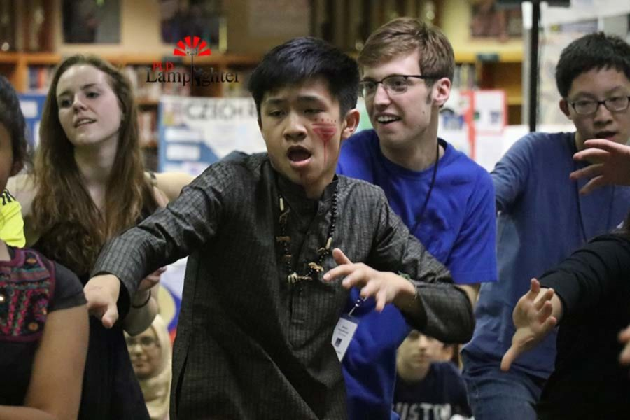 Sophomore William Ding participates in the Bollywood medley dance along with his fellow peers.