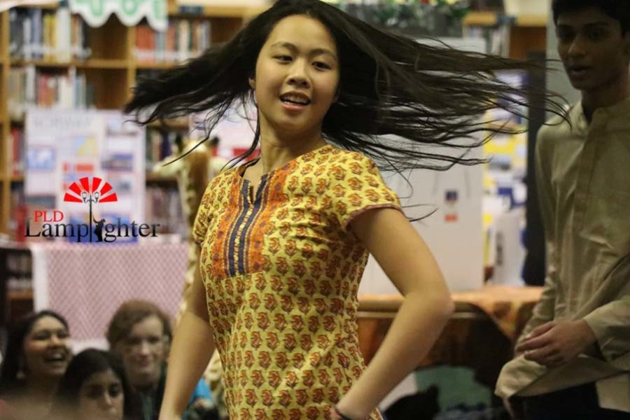 Sophomore Angie Xiao dances during the Bollywood medley.
