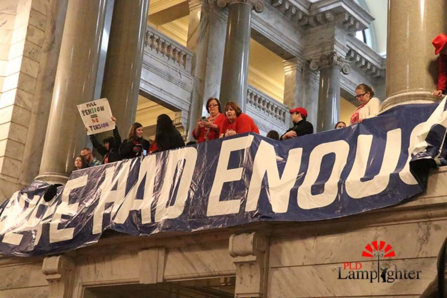 A Weve Had Enough banner hung in the capitol.