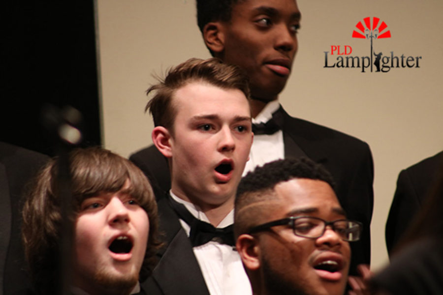 Sophomore Christian Skinker, a tenor, performing