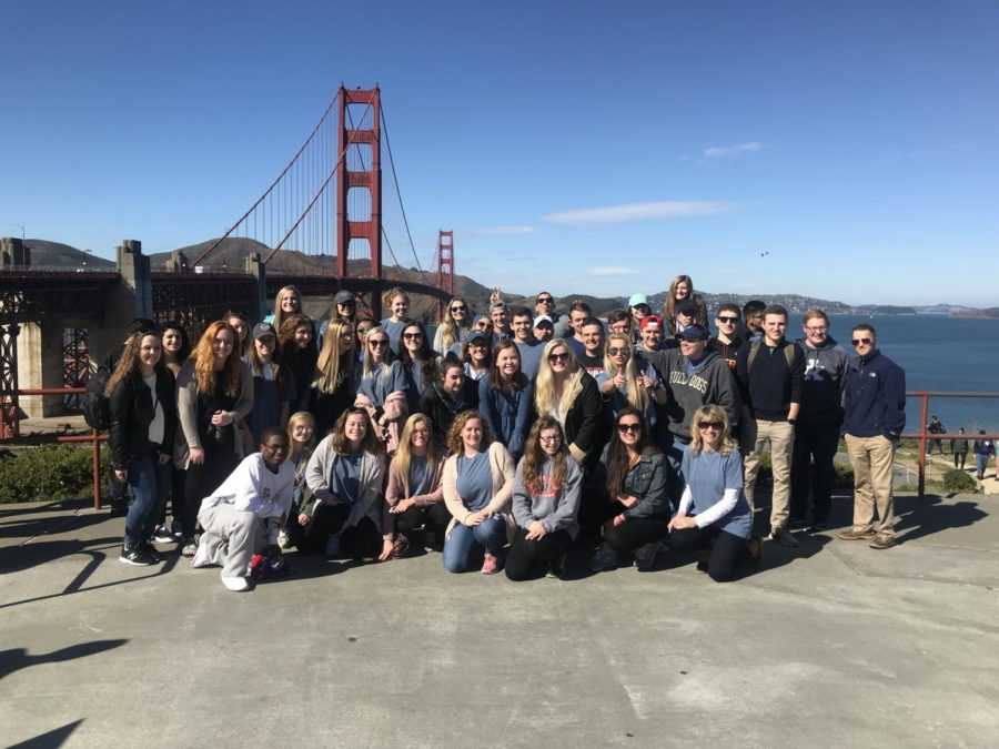 The seniors who went on the trip posing in front of the Golden Gate Bridge.