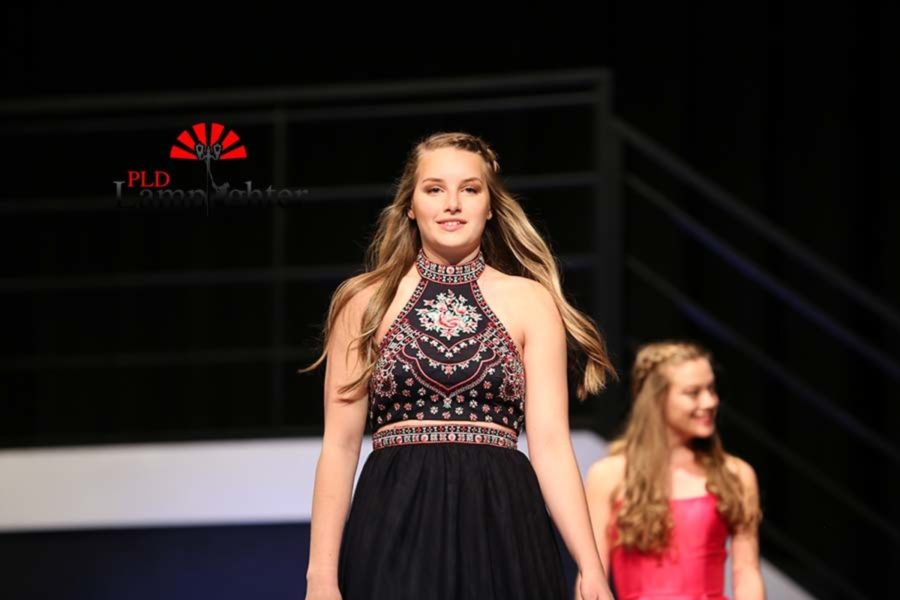 Junior Grace Mortenson walks to the front of the stage.
