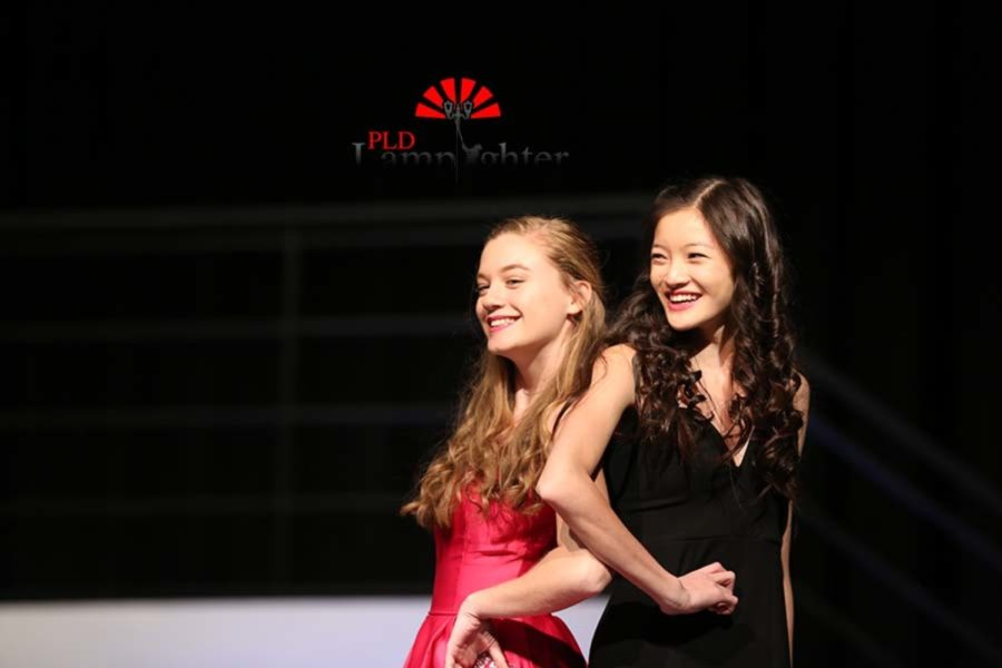 Celina Luo and Megan Dryer pose for the crowd.