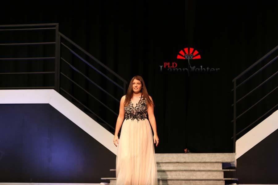 Tori Elias walks out showcasing her dress.