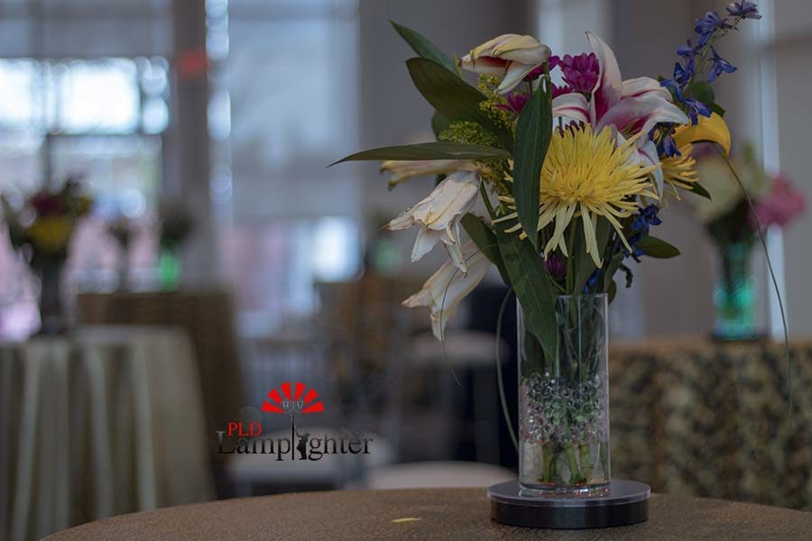 A bouquet of flowers decorating the tables.