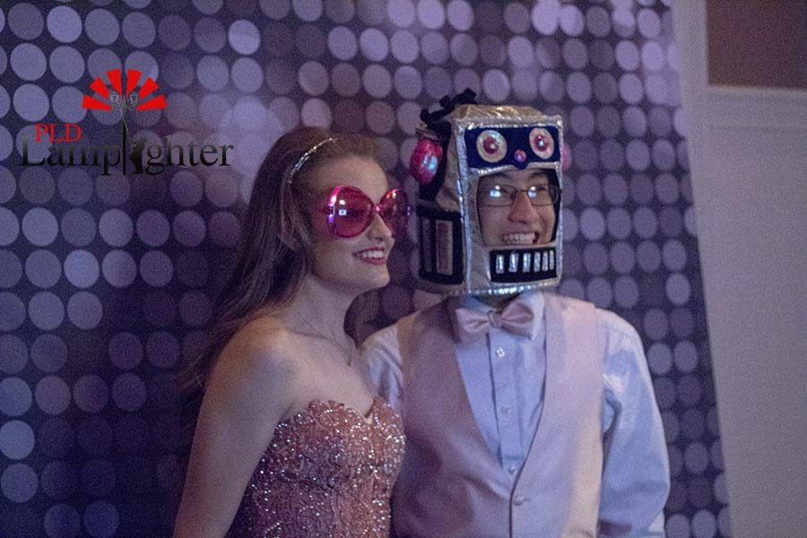 Olivia Tussey and Andy Du pose at the photo booth.