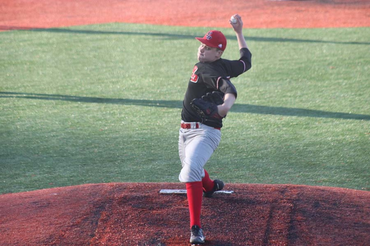 #20 Junior J.P Eisele begins to pitch the ball.