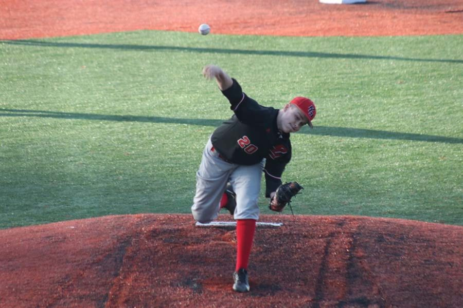 #20 Junior J.P Eisele releases the pitch.