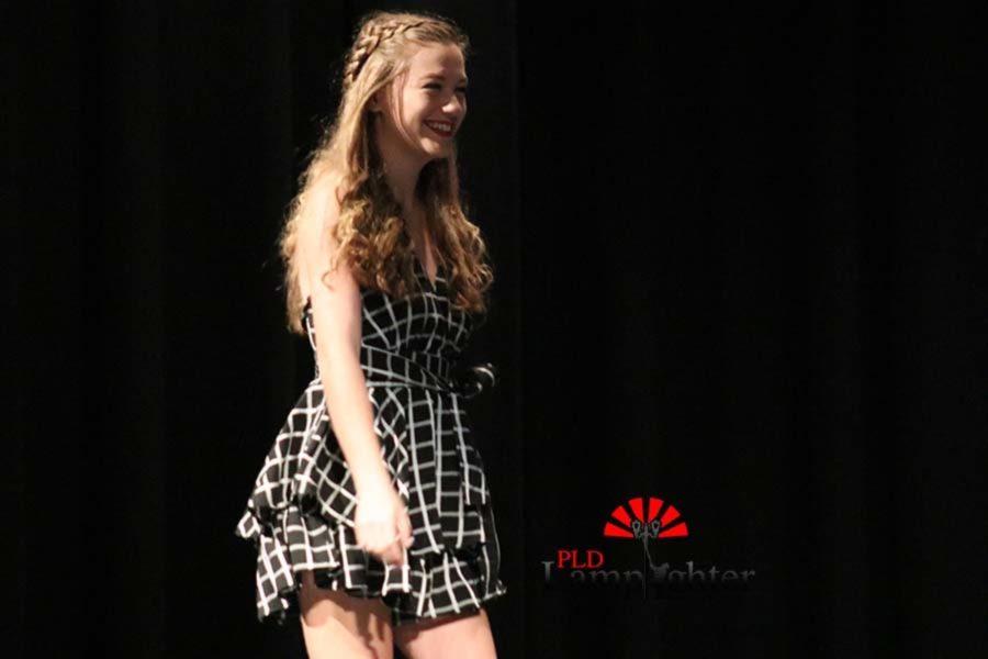 Megan Dryer smiling as she models a romper.