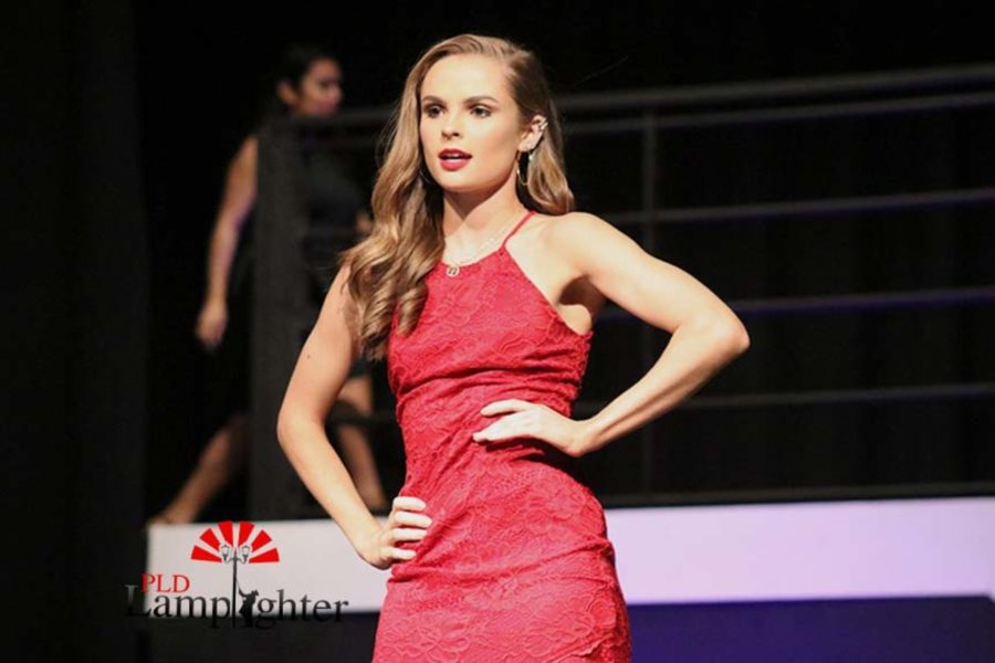 Sophia Mitchell modeling a lace red dress.