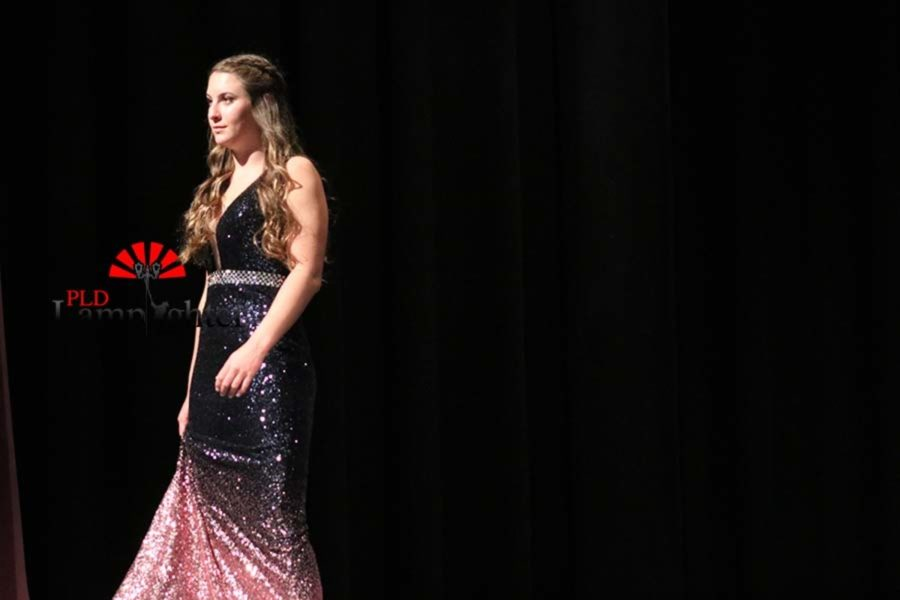 Anna Davis posing in a sparkly ombré gown.