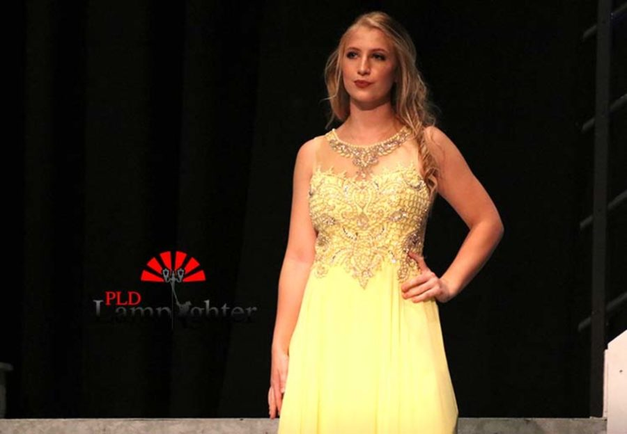 Bailey Conley styling a yellow prom dress.