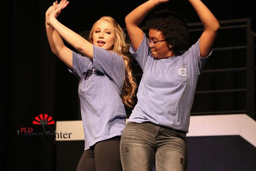 Juniors Bailey Conley and Daisy Garner bump hips in the finale.