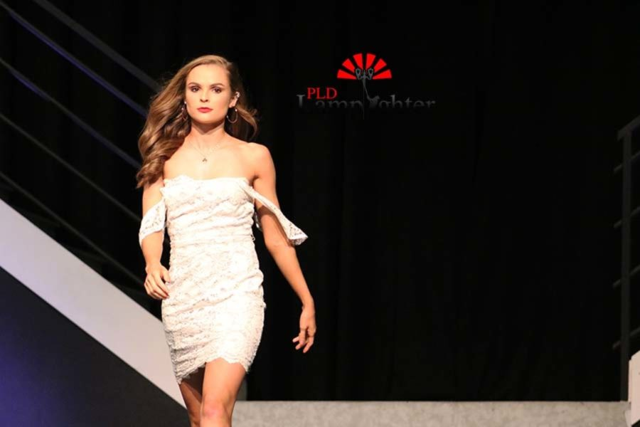 Sophia+Mitchell+showcasing+an+off+the+shoulder+white+dress.