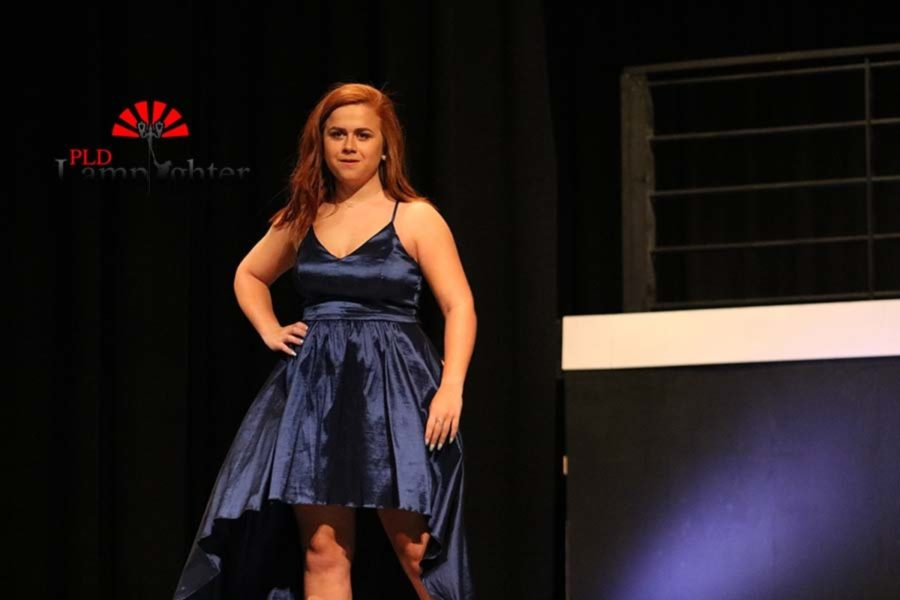 Sophomore Gabby Rudzik models a navy prom dress.