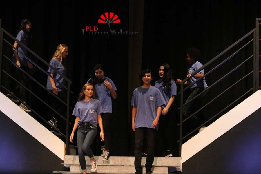 The fashion class walks down the stairs onto the stage for the final bows.