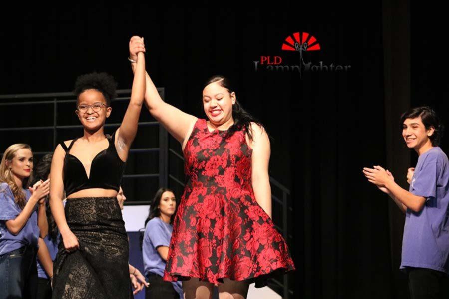 Seniors Daija Parker and Jamara Price raise their hands for applause.