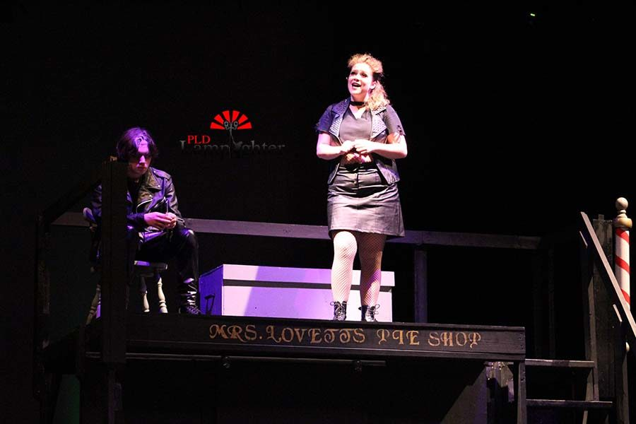 Mrs. Lovett (Mackenzie McConnell) sings a song to Sweeney Todd about her plan.