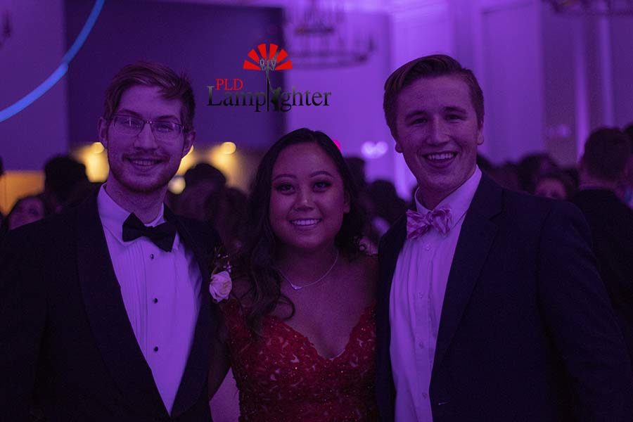 Zach Jones, Katherine Lin, and Carson Sweeney pose for a photo.