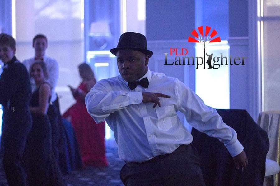 A Dunbar student dancing as prom begins.