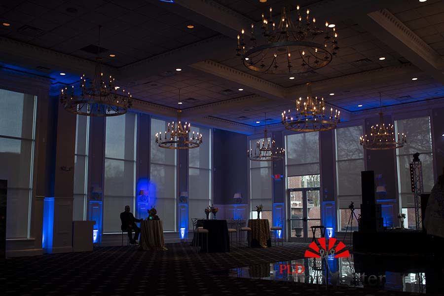 Candlelit chandeliers hanging above the dance floor.
