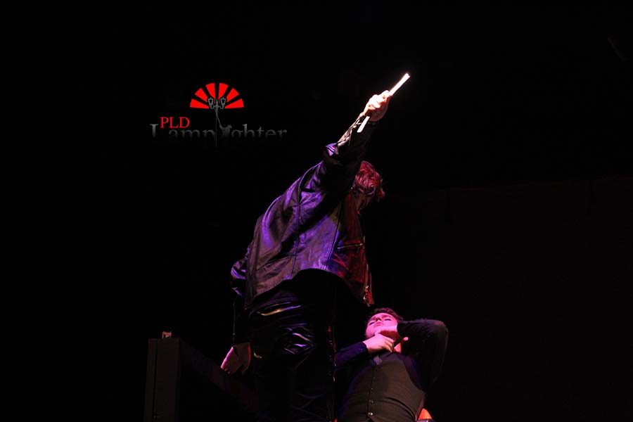 Sweeney Todd (Max Taylor) lifts his knife over his next victim.