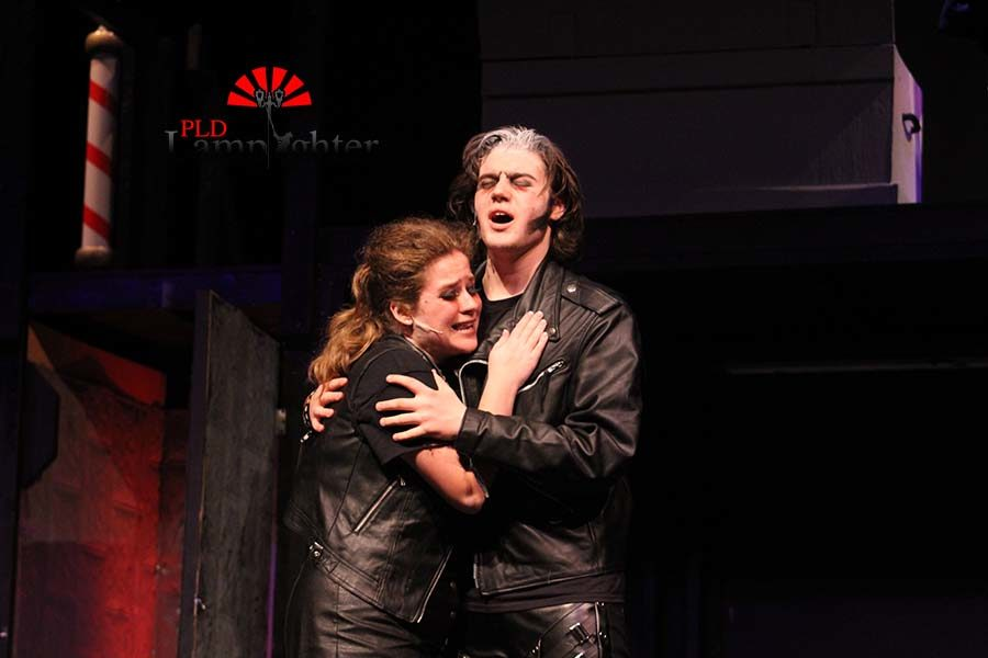 Sweeney Todd (Max Taylor) embraces Mrs. Lovett (Mackenzie McConnell).
