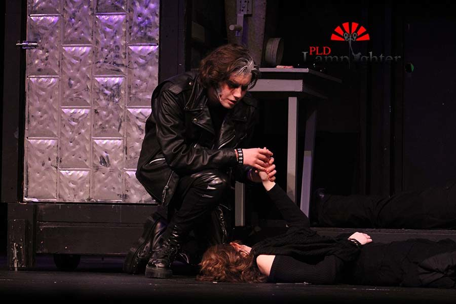 Sweeney Todd (Max Taylor) grasps the hand of his dead wife (Emma Draper).