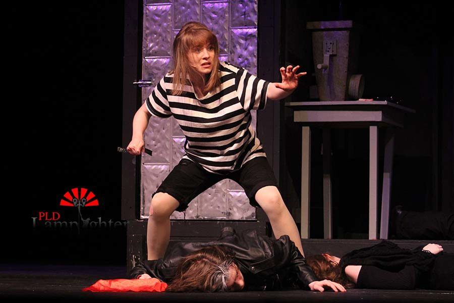 Toby (Katy Rucker) hovers over the dead body of Sweeney Todd (Max Taylor).