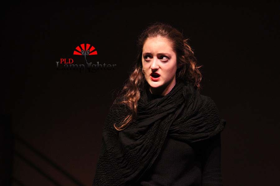 Beggar woman  (Emma Draper) singing a solo.