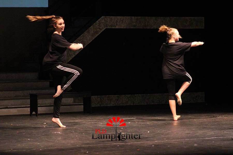 Freshmen Elizabeth Fitzpatrick and Haley Halcomb performs a dance routine during the talent show.