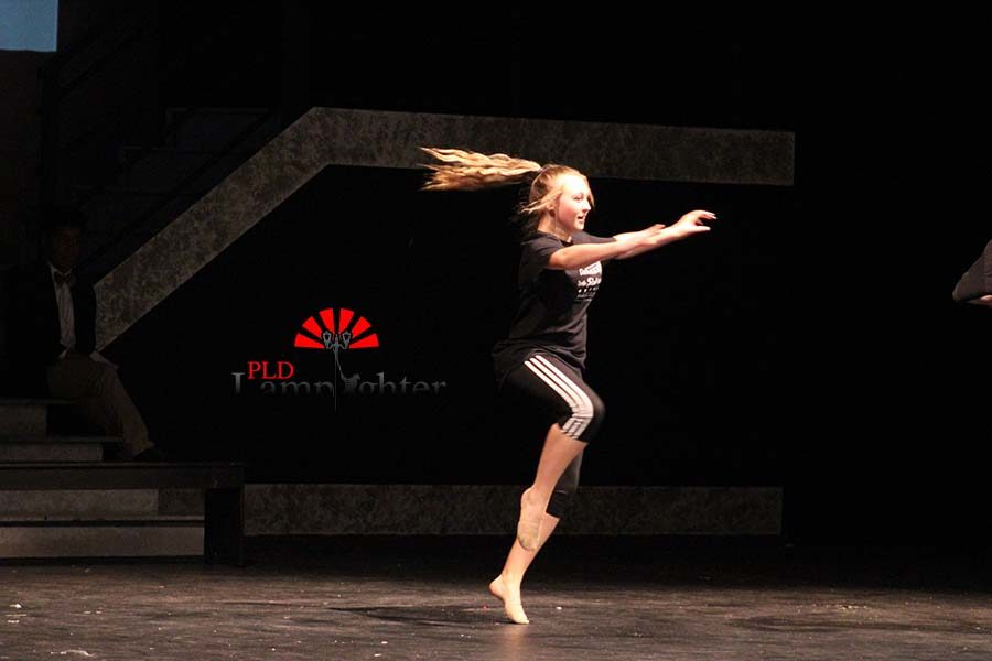 Freshmen Haley Halcomb performs a dance routine during the talent show.