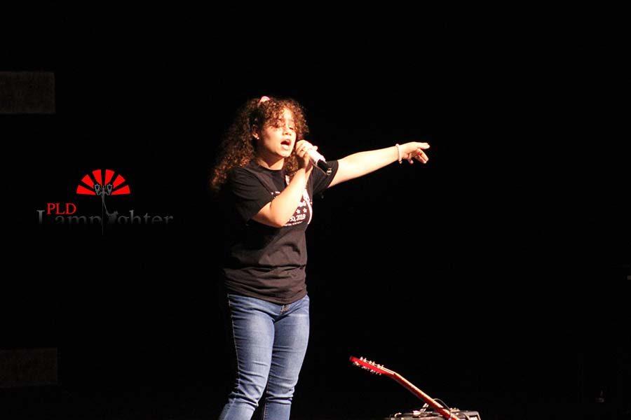 Senior Guliana Benites singing Valerie.