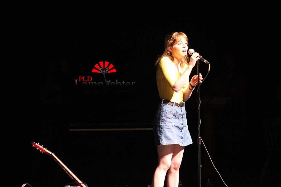 Talent show winner senior Katy Rucker singing