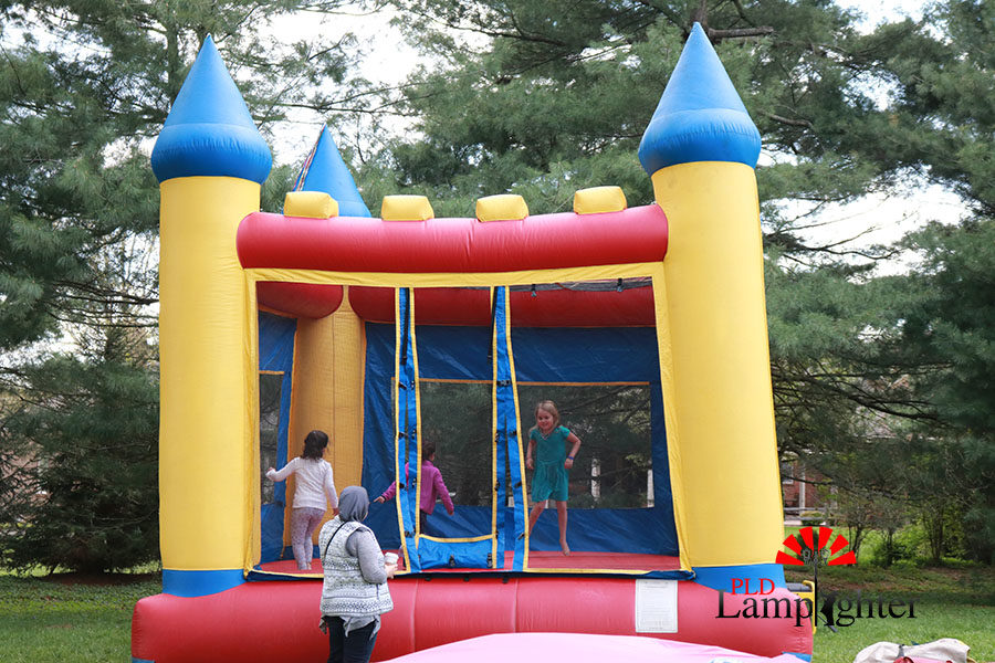 A few neighborhood children play on the bounce-castle during the carnival.