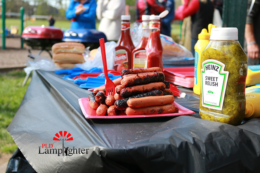 Sitting on one of the tables were hamburgers and hot dogs for the friends and families that attended.