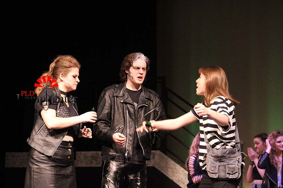 Toby (Katy Rucker) sells the magic hair elixir to Mrs. Lovett (Mackenzie McConnell) and Sweeney Todd (Max Taylor).